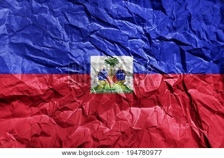 Haiti flag painted on crumpled paper background