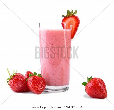 A huge glass with pink drinks or beverages from juicy and fresh red strawberries and organic milk and beautiful strawberries are around, isolated on a white background. Fruit beverage with strawberries and milk.