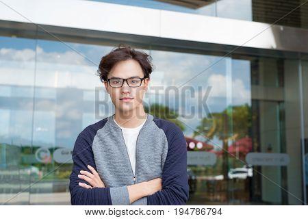 Portrait of an handsome confident businessman outside buidling.