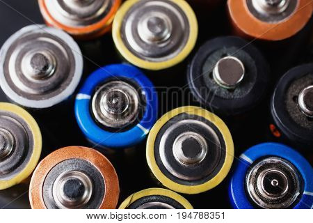 Colored batteries close-up. To save energy. AA alkaline batteries. Colored batteries. Ecological batteries. Litter the nature of batteries