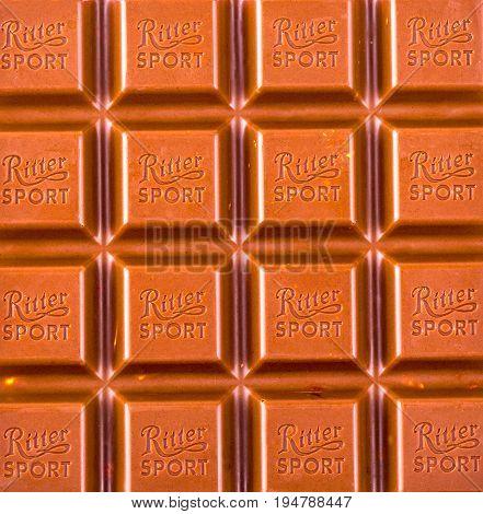Russia Kamchatka- July 11 2017: Ritter Sport milk chocolate bar macro. Ritter Sport chocolate bar made by Alfred Ritter GmbH & Co