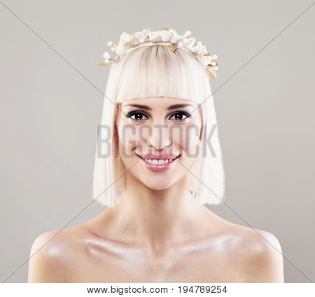 Beautiful Young Woman Bride with Blonde Bob Hairdo Makeup and White Flower Hairdecor