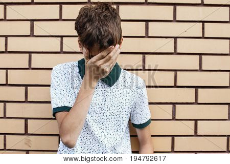 Sad child outdoors. Unhappy teenager. Abuse