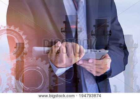 Double exposure of success young businessman working on digital tablet and Gear, machine maintenance at industry concept .