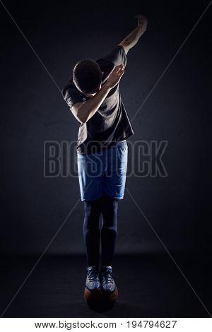 soccer player balance on vintage ball