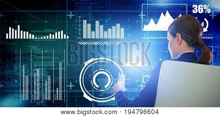 Rear view of businesswoman holding water glass while sitting on chair against digitally generated twinkling light design