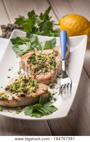 grilled tuna with caper and lemon peel, selective focus
