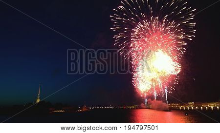 The fireworks in St. Petersburg during the celebration of the graduates Scarlet sails. In the distance are the buildings in the city center and Peter and Paul fortress