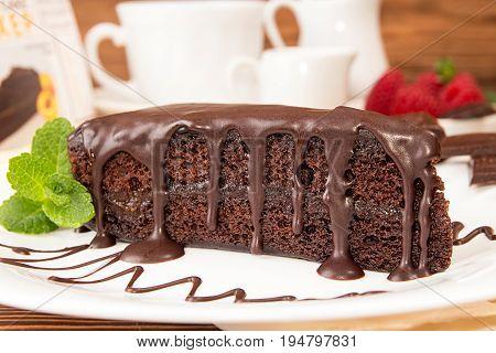 Sachertorte. Piece Of Sacher Cake On White Plate Garnish With Mint And Raspberry.