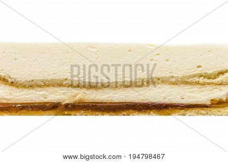 Orange mousse cake texture on white background. Orange biscuit orange mousse cream orange jelly