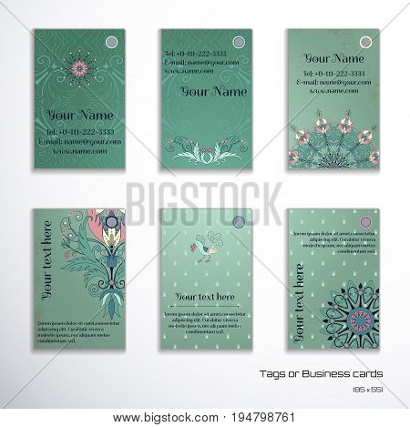 Set of six vertical business cards. Floral pattern on vintage background. Fantasy flowers with leaves and berries. Decorative bird pecks berries. Complied with the standard sizes.