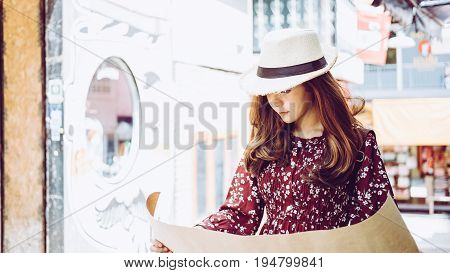 beautiful young asian girl traveling alone at market, vintage tone, hipster girl time