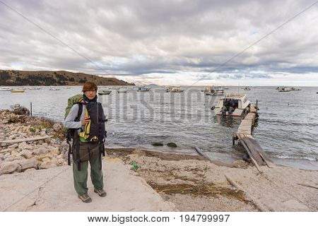 One Person With Backpack Waiting For Boat At Copacabana Pier On Titicaca Lake, Among The Most Scenic