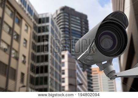 CCTV camera against view of tall buildings