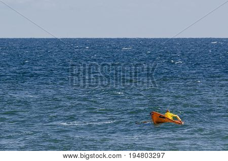 WATER RESCUE - Lifeguard in a boat at sea