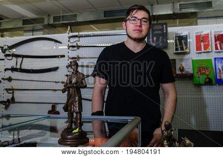 Moscow, Russia - March 19, 2017: Vintage bronze figure of a soldier of the American army of Civil war North and South in an antique store. Selective focus. Seller and cold steel in the background.