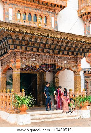 Thimphu, Bhutan - September 10, 2016: Bhutanese Royal Palace Guard With Local Women Wearing Traditio