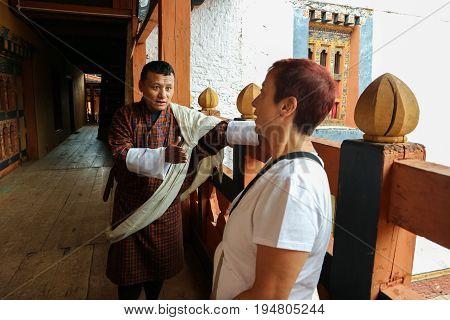 Thimphu, Bhutan - September 10, 2016: Bhutanese Tourist Guide Demonstrating The Temple To The Touris