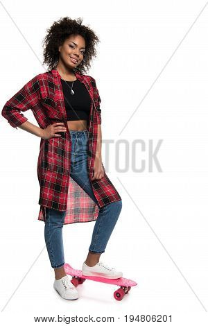 Attractive Young African American Woman Standing With Skateboard And Looking At Camera Isolated On W