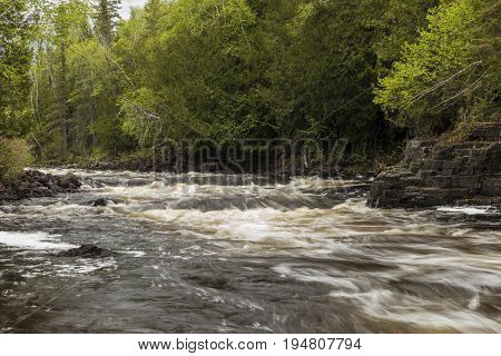 Current River Cascades - A river with cascading rapids.
