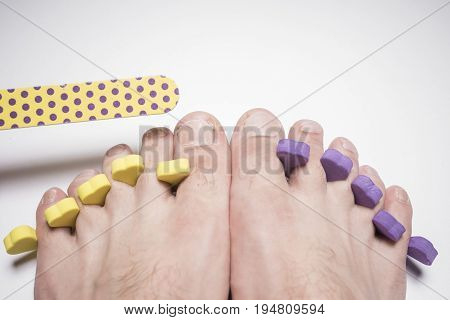 Male pedicure and nail file isolated on white