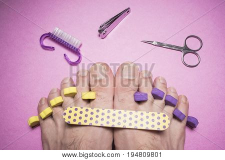 Male pedicure nail file scissors on a pink background