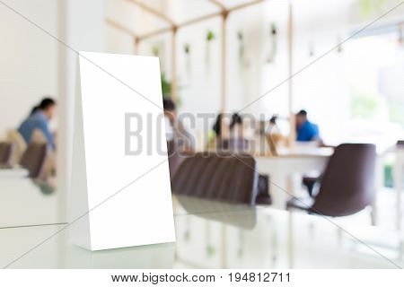 Mock up blank template menu frame in restaurant with blurred background Clipping path included