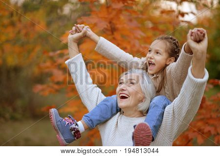 Portrait of grandmother and grand daughter having fun  outdoors