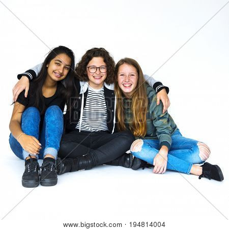 Group of girlfriends smiling and huddle together