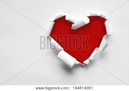 pink paper teared in heart shape with black space for text copy oy every design.