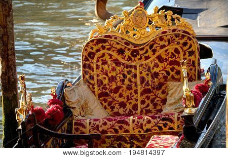 Close up of a red and yellow seat in a gondola.
