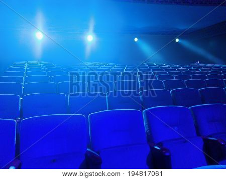 free diagonal perspective Cinema  theater seats with projection light falling