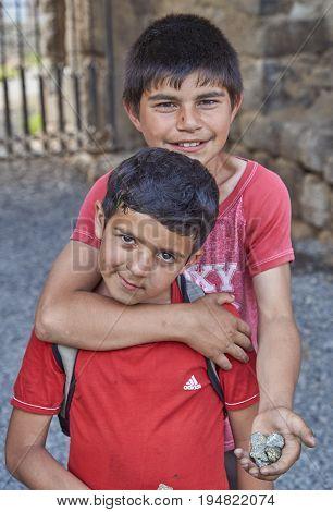 Akhtala, Armenia-6 june, 2017. Poor armenian children sell chalcopyrite to foreigners