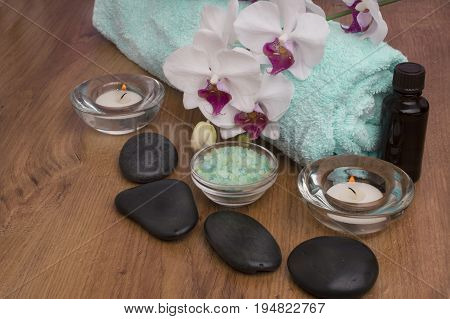 zen basalt stones and orchid on the wood. spa Background