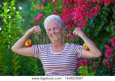 strong fit active smiling senior woman