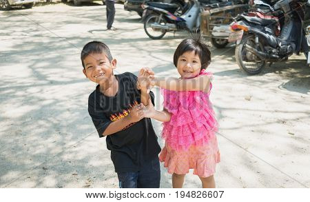 Songkhla Thailand - April 8 2017 : Boy and girl having fun together at Wat Kongkawadee in Songkhla Thailand