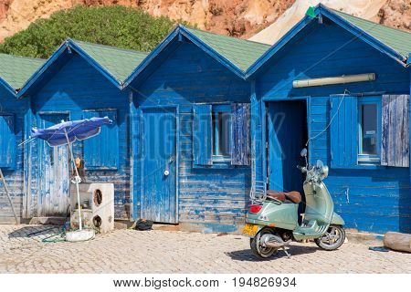 ALBUFEIRA, PORTUGAL - AUGUST 25, 2016: Typical small fishermen wooden houses in Olhos de Agua, Algarve, Portugal.