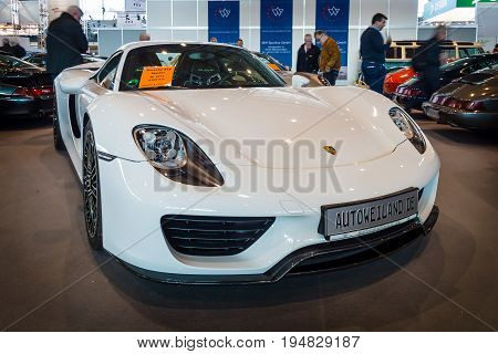 STUTTGART GERMANY - MARCH 17 2016: Mid-engined plug-in hybrid sports car Porsche 918 Spyder 2015. Europe's greatest classic car exhibition