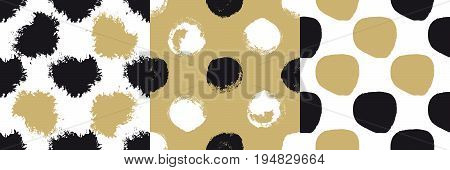 Decorative seamless patterns set with brush drawn circles, hearts and blobs isolated on golden and white background. Abstract acrylic spots in grunge style for textile design. Vector illustration