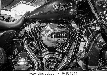 STUTTGART GERMANY - MARCH 17 2016: Fragment of a motorcycle Harley-Davidson Road King 2016. Black and white. Europe's greatest classic car exhibition