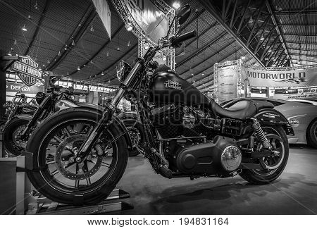 STUTTGART GERMANY - MARCH 17 2016: Motorcycle Harley-Davidson Dyna Street Bob 2016. Black and white. Europe's greatest classic car exhibition