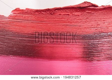 Mix lipstick smudged samples closeup backdrop. Cosmetics commercial background, female style. Glamorous magazine, beauty concept
