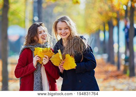 Two Young Girls On A Sunny Fall Day