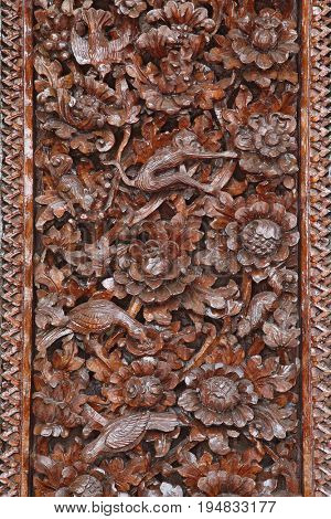 Hand carved crafted wood on teample door