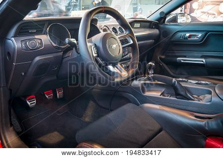 STUTTGART GERMANY - MARCH 17 2016: Cabin of pony car Ford Mustang GT fastback coupe (sixth generation) 2015. Europe's greatest classic car exhibition