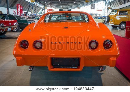 STUTTGART GERMANY - MARCH 17 2016: Sports car Chevrolet Corvette Stingray Coupe (C3) 1975. Rear view. Europe's greatest classic car exhibition
