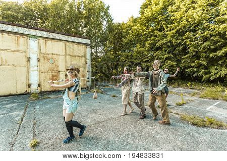 Zombies Go For Meat On A Stick, Zombies In Harness And Skateboarder