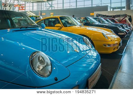 STUTTGART GERMANY - MARCH 17 2016: Various models of Porsche sports cars stand in a row. Europe's greatest classic car exhibition