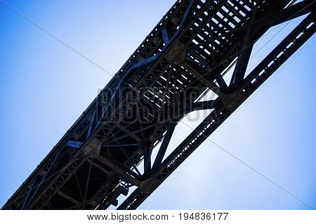 Train Bridge Silhouetted Against A Brilliant Blue Sky