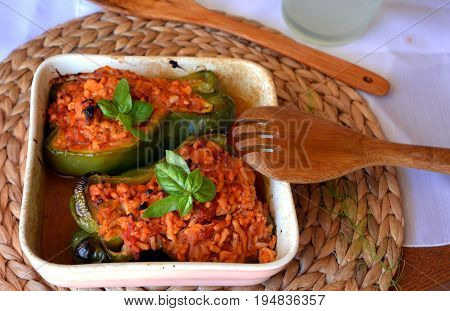 Stuffed green bell peppers with ground beef on a bowl. Healthy summer food.